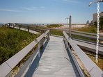 Community boardwalk leading to beach and Gulf