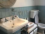 Large bathroom with good sized basin, shower and roll top bath