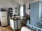 Kitchen and island with smeg dishwasher and fridge freezer