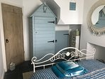 Double bedroom with beach hut style wardrobe overlooking the water