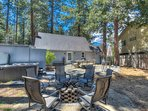 Backyard oasis! Brand new landscaping includes fire-pit and comfortable seating for all to enjoy!