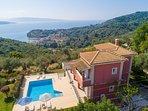 Aerial view of Villa Eleni Agios Stephanos with view towards St. Stephanos