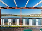 View from the Master bedroom across the lagoon to the Knysna Heads