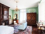 The bedroom has another Louis XIV fireplace, and a tall French door leading to the balcony.