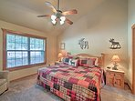 Two lucky guests can claim this master bedroom!