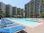 Plenty of space to sit and relax near the large pool for those who prefer to stay dry.