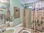 Wash your worries away in the shower/tub combo in this full bathroom.