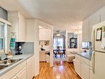 Hardwood floors accent the the bright finishings in the fully equipped kitchen.