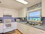 Ample counter space and delightful decor make cooking here a breeze.