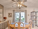 Savor your home-cooked meals at the 4-person hardwood dining table.