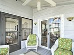 Step out onto the lanai and rest in screened-in comfort on a wicker chair.