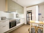 A fully decked kitchen & dining.