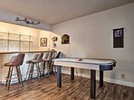 Mix a nightcap beverage at the wet bar and challenge your friends to a game of air hockey.