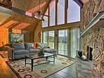 Spread out and relax with family and friends at this 3-story vacation rental cabin in Lake Arrowhead.