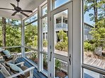 The screened porch backs up to the boardwalk to the beach.