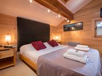 Charming bedroom with double bed and television
