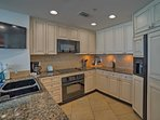 Granite countertops provide ample space for all your food prep needs!