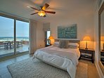 Two lucky travelers can claim this king master bedroom.