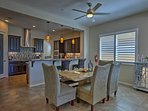 Share a meal together around the dining table with comfortable chairs.
