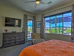 The master bedroom also features a flat-screen Smart TV and patio access.