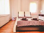Comfortable Double Bed in a Well Lit Sleeping Area