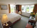 Master bedroom with door opening onto terrace
