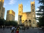 Take in the 300-year-old Notre Dame Basilica. Get off at the Square Victoria metro station.