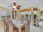 Elegant dining for 6, with a stunning view. The living and dining area's fully retractable doors open to the fully...