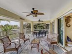 Take relaxation to whole new level as you lounge and dine on the fully screened porch overlooking Bonita Spring's...