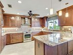 Upgraded in every way possible with granite counters, glass tile backsplash, soft close clabinets, stainless steel...