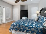 The first-Level Guest Bedroom features a full bed with spacious, 9' ceilings & warm hard wood floors