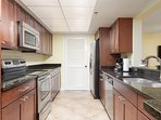 Long Beach Resort 1206 features a galley kitchen with stainless steel appliances and granite countertops