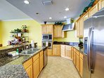HUGE kitchen with granite countertops and stainless steel appliances!