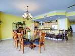 Dining area with upgraded appliances and dine-in bar eating area.