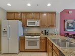 Fully equipped kitchen with granite counter tops, high end appliances and everything you need for great family meals