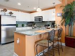 Stainless steel appliances and granite countertops make this open kitchen a real pleasure to create in