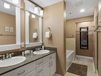 Master Bath features dual vanities, separate tub and walk in shower and plenty of closet space