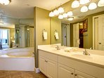 Master Bath features Tile Floors, Jacuzzi Tub, and Walk-in Shower