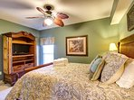 Queen Bedroom features Ornate Ceiling Fan, HDTV with DVD, Huge Closet, and Ample Natural Light