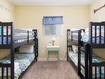Guest Bedroom #1 is a custom bunk room with (4) twin beds