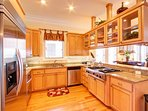 Beautiful and Open Kitchen with All Stainless Appliances and Tons of Custom Cabinetry!