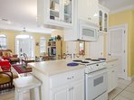 Open ended L Shaped Kitchen with custom cabinets and many upgrades