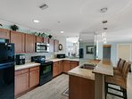 This kitchen is HUGE and features granite counter tops, high end appliances and every convenience you'll need to...
