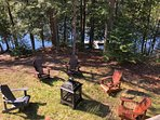 Outside fireplace with Adirondack chairs (and the dock)