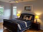 Bedroom #2 in the upper level (queen bed) w/ beautiful view of golf course (with fan)