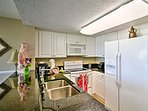 Use the fully equipped kitchen to prepare meals for your crew.