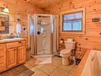 Go for a soak in the tub or rinse off in the walk-in shower.