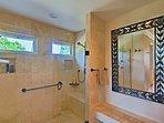 Enjoy a rinse in the spacious walk-in shower.