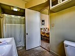 The first-floor bathroom has a shower/tub combo.