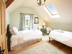 Chittenango Room first floor ensuite with a shower room and wc, with twin size antique beds